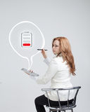Woman holding tablet and pen, battery level icon Royalty Free Stock Photography