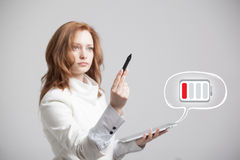 Woman holding tablet and pen, battery level icon Royalty Free Stock Photos