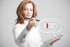 Woman holding tablet and pen, battery level icon Stock Photography