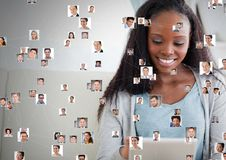 Woman holding tablet with Profile portraits of people contacts Stock Photo
