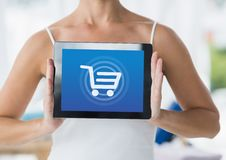Woman holding Tablet with Shopping trolley icon Stock Photos