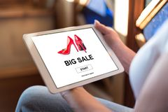 Big sale concept on a tablet. Woman holding a tablet showing big sale concept Royalty Free Stock Photos