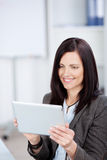 Woman holding a tablet Stock Photo
