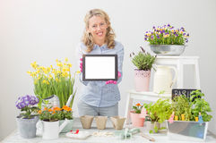 Woman holding tablet and smiling Royalty Free Stock Image