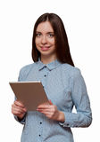 Woman holding a tablet and smiling Stock Photo