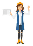 Woman holding tablet Stock Images