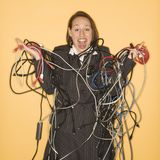Woman Holding Tangled Wires. Royalty Free Stock Photos