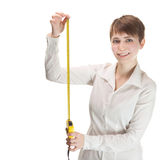 Woman holding a tape measure Stock Image