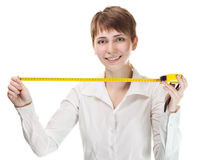 Woman holding a tape measure Stock Images