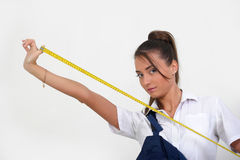 Woman holding tape measure Royalty Free Stock Photo