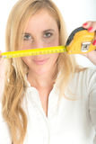 Woman holding a tape measure Royalty Free Stock Image