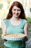 Woman holding tart Stock Images