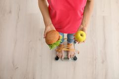Woman holding tasty sandwich and fresh appl Royalty Free Stock Photography