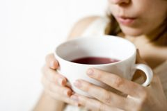 Woman holding tea Stock Photo