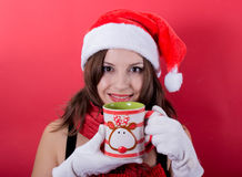 Woman holding tea cup on red background Stock Photography