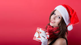 Woman holding tea cup on red background Stock Image