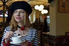 Woman Holding Tea Cup and Saucer royalty free stock photo