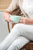 Woman Holding Tea Mug In Hand Royalty Free Stock Photos