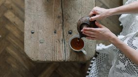 Free Woman Holding Teapot And Pouring Tea In Cup Stock Images - 159639694