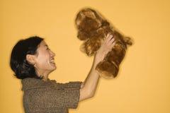 Woman holding teddy bear. Stock Photos
