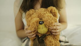 Woman holding teddy bear. Close up. White background 4k 20s.  stock video