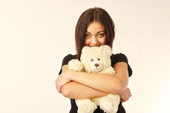 Woman holding a teddy bear. Cute woman holding a teddy bear Royalty Free Stock Images