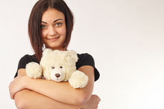 Woman holding a teddy bear. Cute woman holding a teddy bear Royalty Free Stock Photography