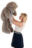 Woman holding a teddy bear Stock Photos