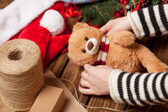Woman holding teddy bear toy. Before wrapping. High point of view Stock Image
