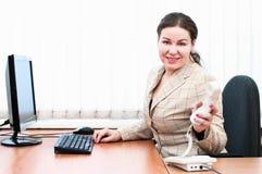Woman holding telephone handset Royalty Free Stock Photo