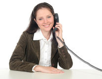 Woman holding a telephone handset Stock Images