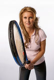 Woman holding a tennis racket Stock Photos