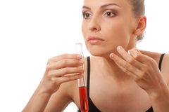 Woman holding test tube with red  liquid Royalty Free Stock Image