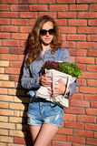 Woman is holding in their hands a bag full of lettuce Stock Photo