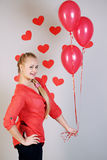Woman holding three balloons Royalty Free Stock Photography
