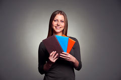 Woman holding three books Royalty Free Stock Photos