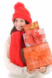 Woman holding three gifts smiling Royalty Free Stock Photography
