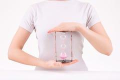Woman holding three-leveled hourglass Stock Photo