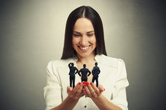 Woman holding three men Stock Images