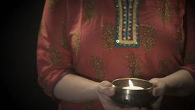 Woman holding tibetian singing bowl with candle stock video footage