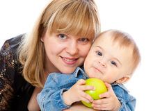 A woman is holding tight her child Stock Photography
