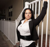 Woman holding on to a rail Stock Image