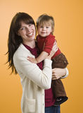 Woman Holding Toddler Stock Photo