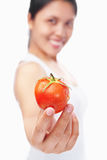Woman holding tomato Stock Images