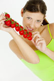 Woman holding tomatoes Stock Image