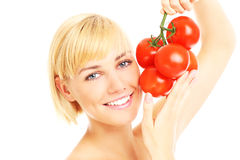 Woman holding tomatoes Stock Images