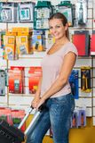 Woman Holding Tool Case In Hardware Store Royalty Free Stock Photo