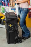 Woman Holding Tool Case In Store Royalty Free Stock Photo