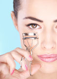Woman holding tool for eyelash Stock Photo