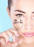 Woman holding tool for eyelash. Pretty woman holding tool for eyelash Stock Photo